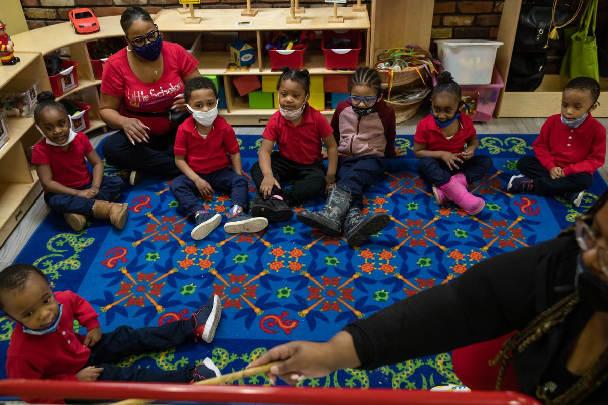 Preschoolers participate in morning exercises at Little Scholars child care center.