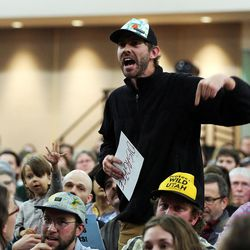 Jesse Brown asks Rep. Jason Chaffetz a question during a town hall meeting in Cottonwood Heights on Thursday, Feb. 9, 2017.