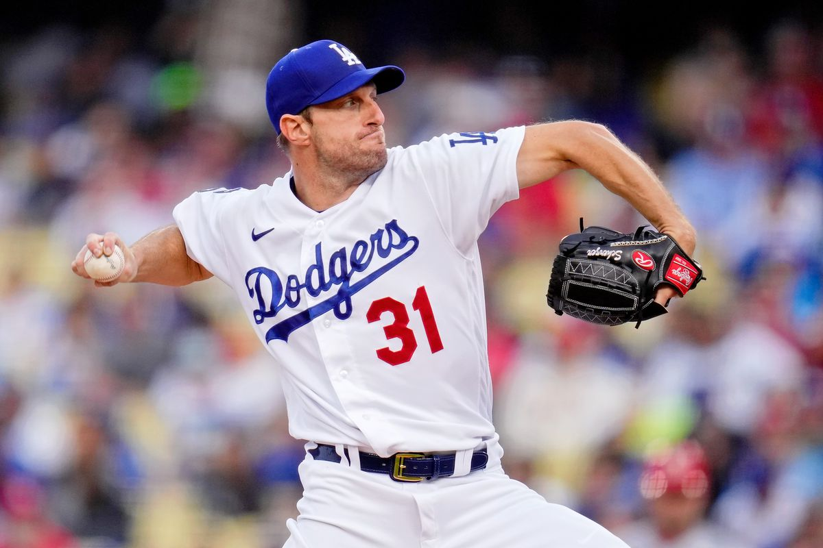 Los Angeles Dodgers starting pitcher Max Scherzer (31) pitches against the St. Louis Cardinals during the second inning at Dodger Stadium.