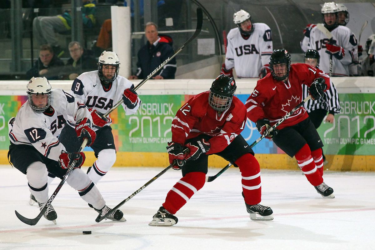 Jack Eichel (left) fights for the puck with Eric Connolly of Canada.