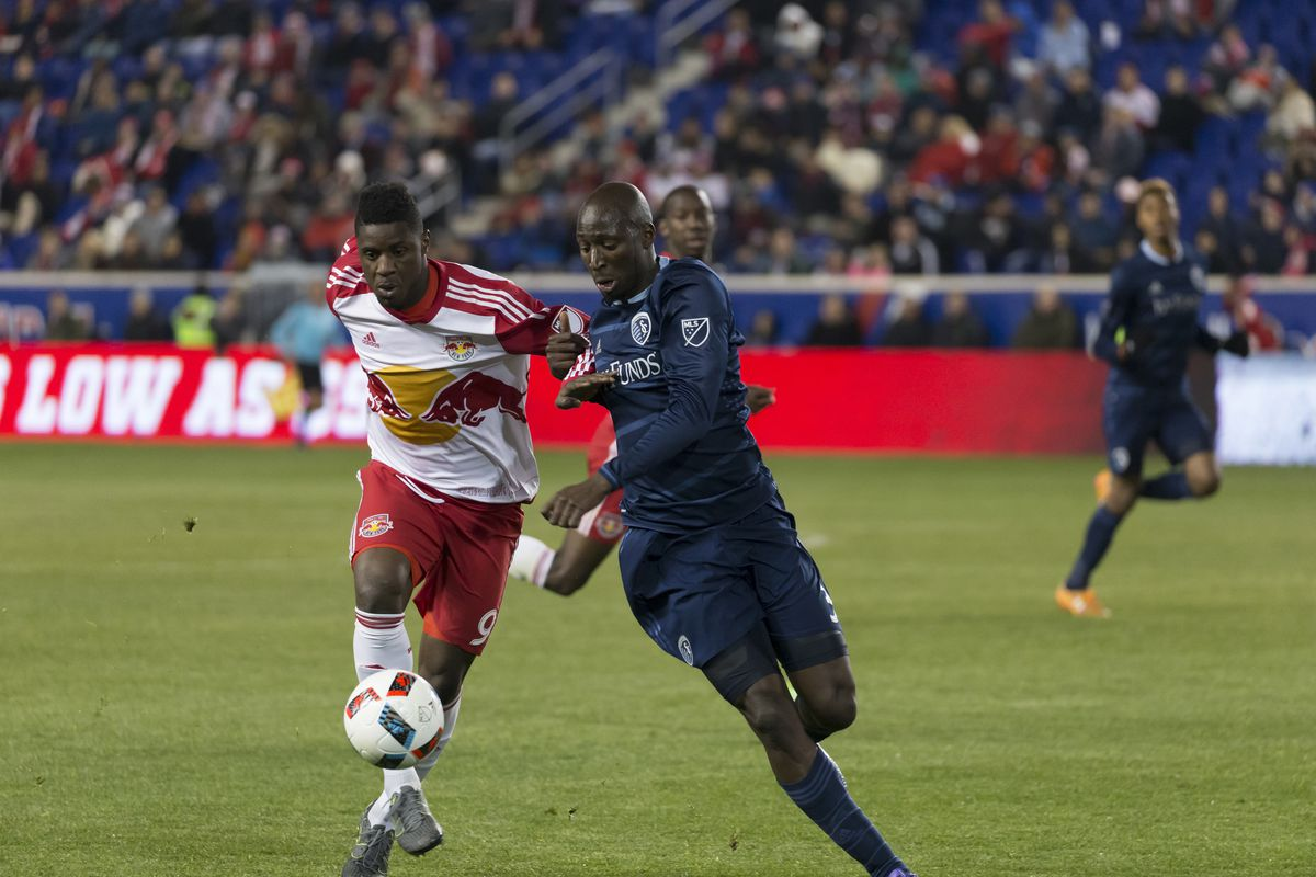 Sporting Kansas City defense man Ike Opara (3) fights for...