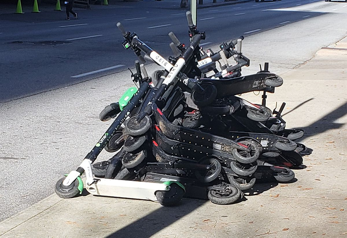 a picture of e-scooters in a pile
