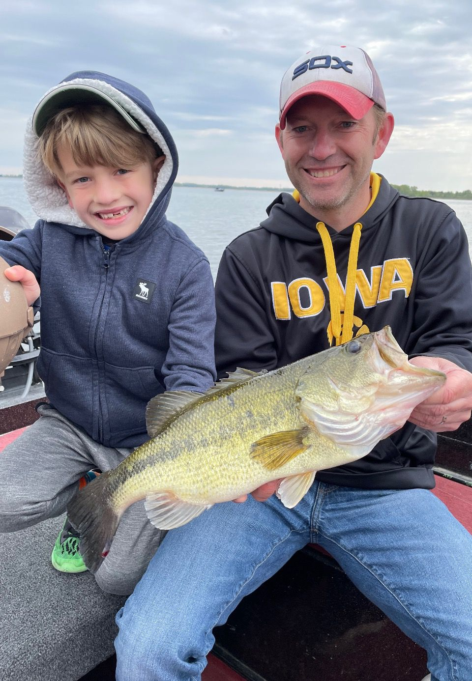 Tim O'Connell, of Sugar Grove, holding a 19-inch largemouth bass caught by Will, his 8-year-old son, on a recent guide trip with Mike Norris. Provided photo