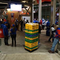 Food workers carting away supplies at the end of the game