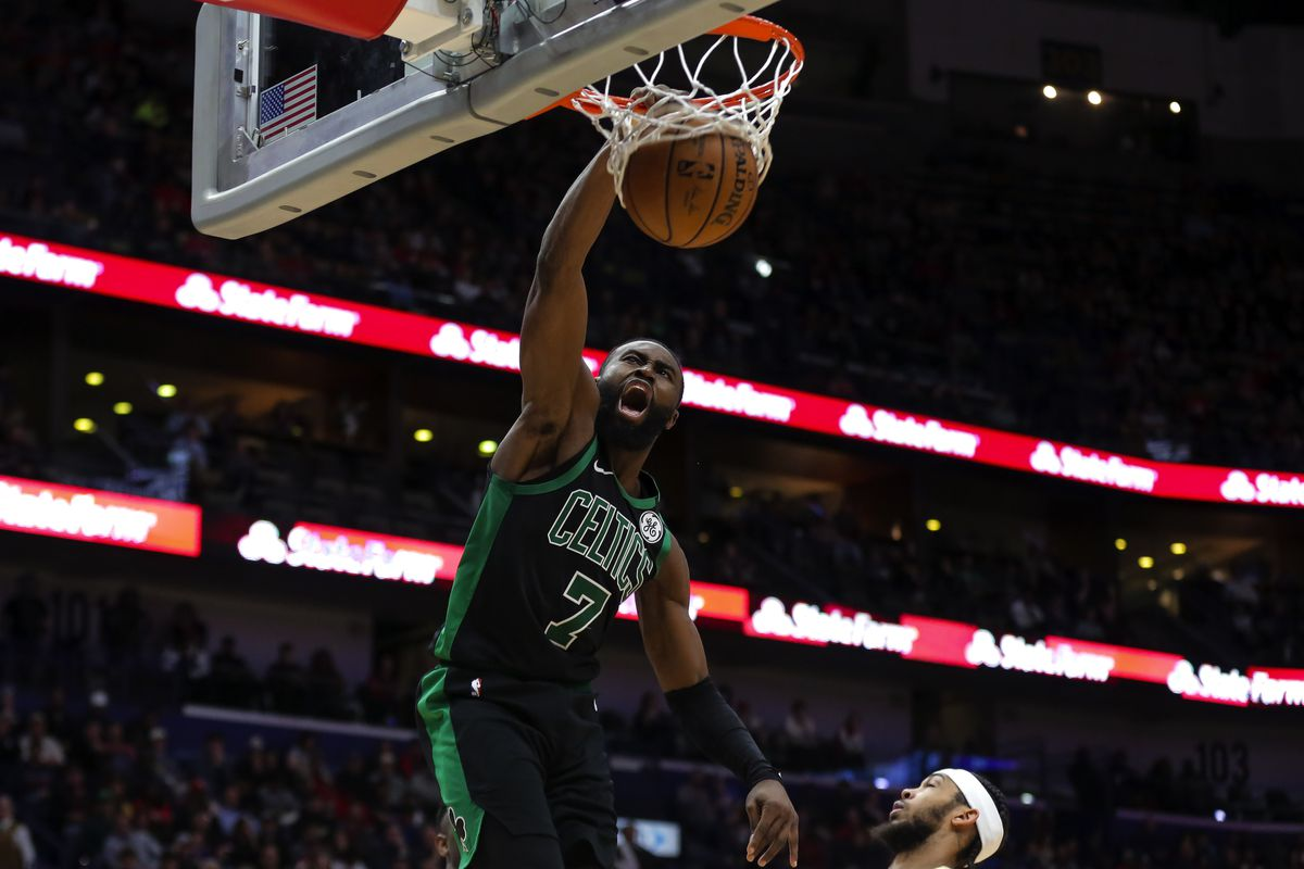 Boston Celtics guard Jaylen Brown dunks the ball against the New Orleans Pelicans during the second half at the Smoothie King Center.