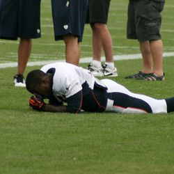 Broncos RB Ronnie Hillman takes a breather between drills