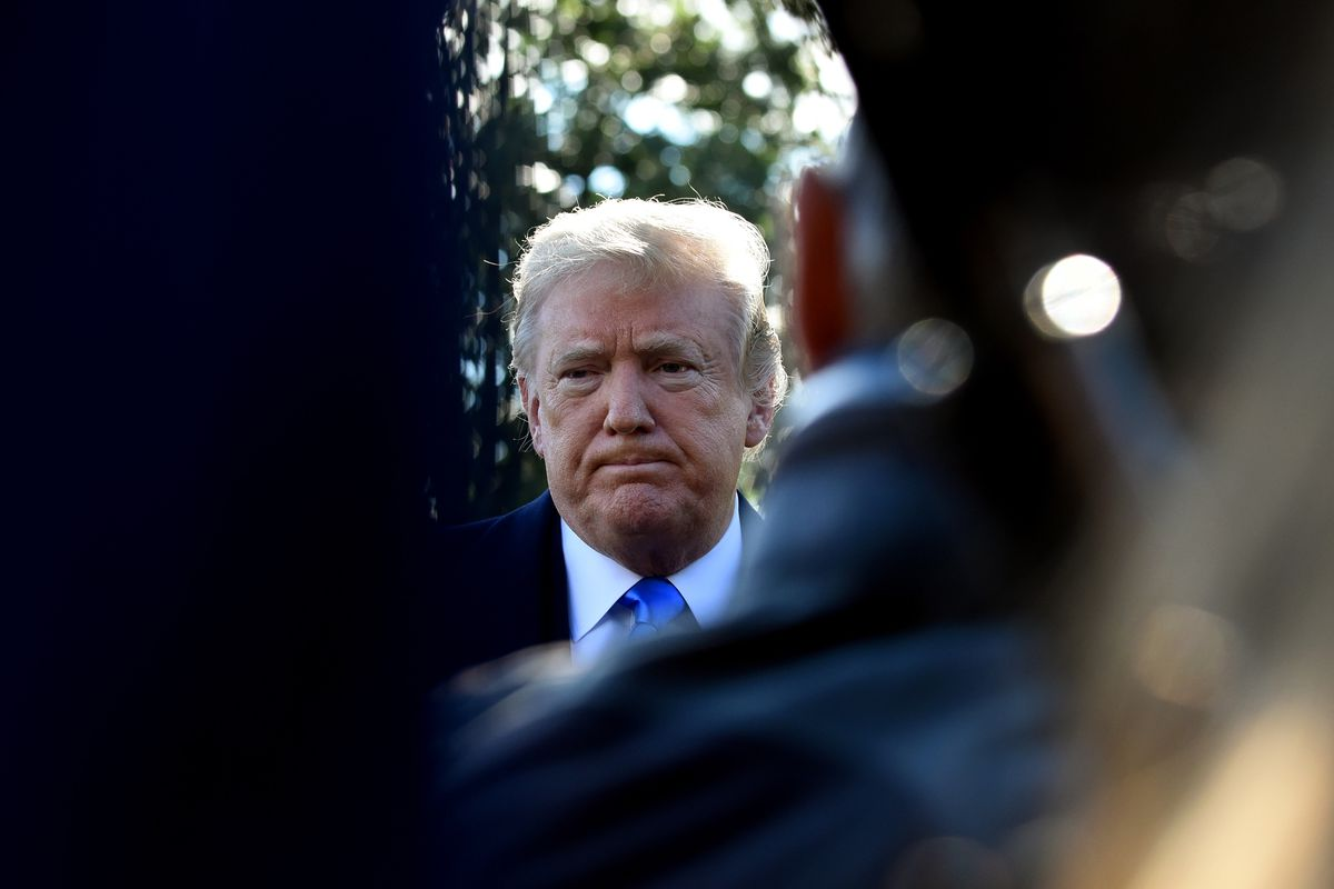 President Donald Trump speaks with reporters before boarding Marine One at the White House in October 2018.