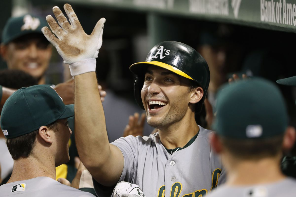 Sep 13, 2017; Boston, MA, USA; Oakland Athletics first baseman Matt Olson (28) is congratulated in the dugout after hitting a two-run home run against the Boston Red Sox during the first inning at Fenway Park. Mandatory Credit: Winslow Townson-USA TODAY Sports