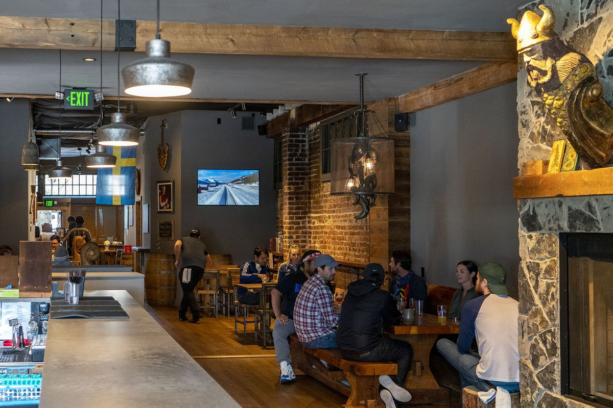 Skal Beer Hall's indoor dining room, with a Viking statue on the wall