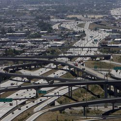 Traffic moves about the I-15 and I-80 interchange in Salt Lake City.