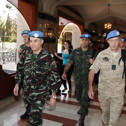 U.N. observers, led by Moroccan Col. Ahmed Himmiche, left, leave the Sheraton Hotel in Damascus, Syria, Monday, April 16, 2012.