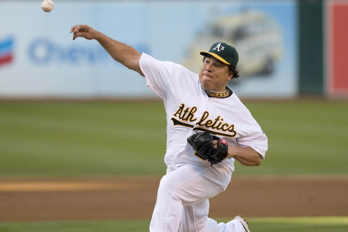 August 18, 2012; Oakland, CA, USA; Oakland Athletics starting pitcher Bartolo Colon (21) pitches against the Cleveland Indians during the fourth inning at O.co Coliseum.  Mandatory Credit: Ed Szczepanski-US PRESSWIRE