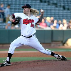 The Salt Lake Bees' John Lamb throws a pitch during a baseball game against the Reno Aces at Smith's Ballpark in Salt Lake City on Monday, June 26, 2017. The Bees wore Trappers jerseys for '80s throwback night.