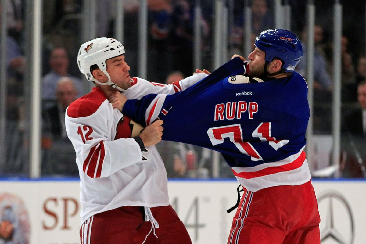 Paul Bissonnette #12 of the Phoenix Coyotes fights Mike Rupp #71 of the New York Rangers at Madison Square Garden on January 10, 2012 in New York City.  (Photo by Chris Trotman/Getty Images)