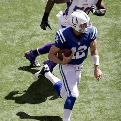 Indianapolis Colts quarterback Andrew Luck is chased by Minnesota Vikings' Erin Henderson during the first half of an NFL football game in Indianapolis, Sunday, Sept. 16, 2012.