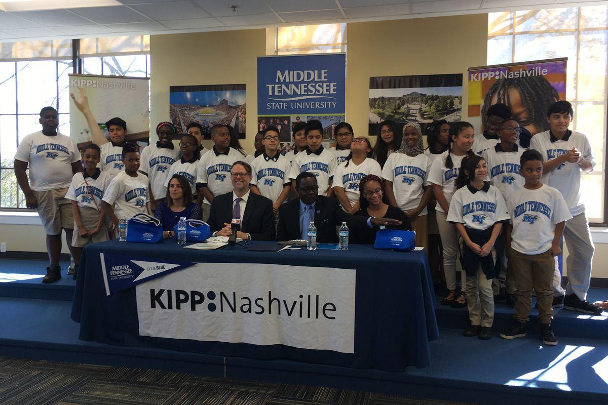 Seventh-grade students at KIPP Academy Nashville pose with (from left) School Leader Laura Miguez Howarth, KIPP Nashville Executive Director Randy Dowell, MTSU President Sidney McPhee and MTSU student Deyauna Cook.