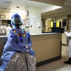 A Christmas tree decorated with personal protective equipment greets patients and health care workers as they enter the Intensive Care Unit at Roseland Community Hospital on the Far South Side, Tuesday afternoon, Dec. 8, 2020.
