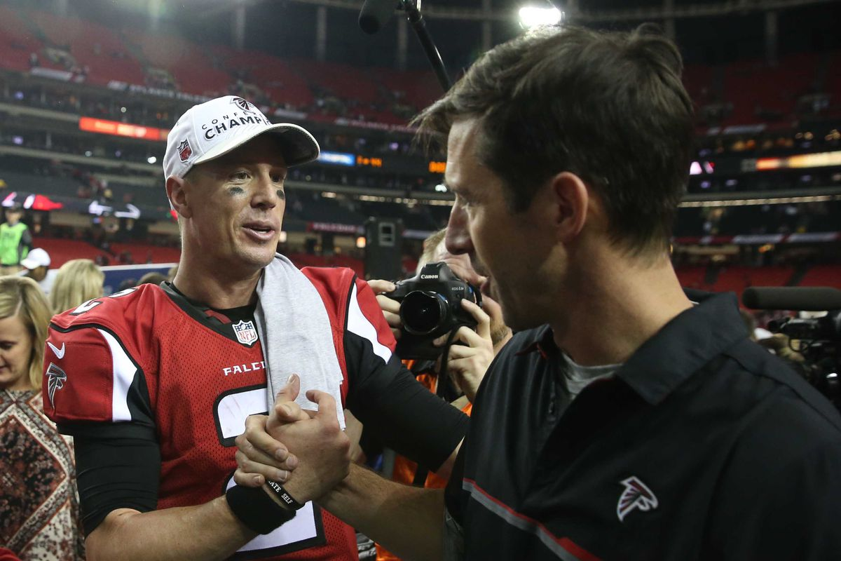 Atlanta Falcons quarterback Matt Ryan speaks with offensive coordinator Kyle Shanahan after the game against the Green Bay Packers in the 2017 NFC Championship Game at the Georgia Dome.