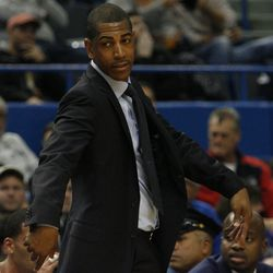 UConn head coach Kevin Ollie looks on to the action.