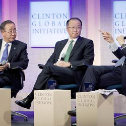 Ban Ki-Moon, left, Secretary-General of the United Nations, and Jim Yong Kim, center, President of the World Bank, listen to former U.S. President Bill Clinton during a panel discussion at the Clinton Global Initiative, Sunday, Sept. 23, 2012 in New York.
