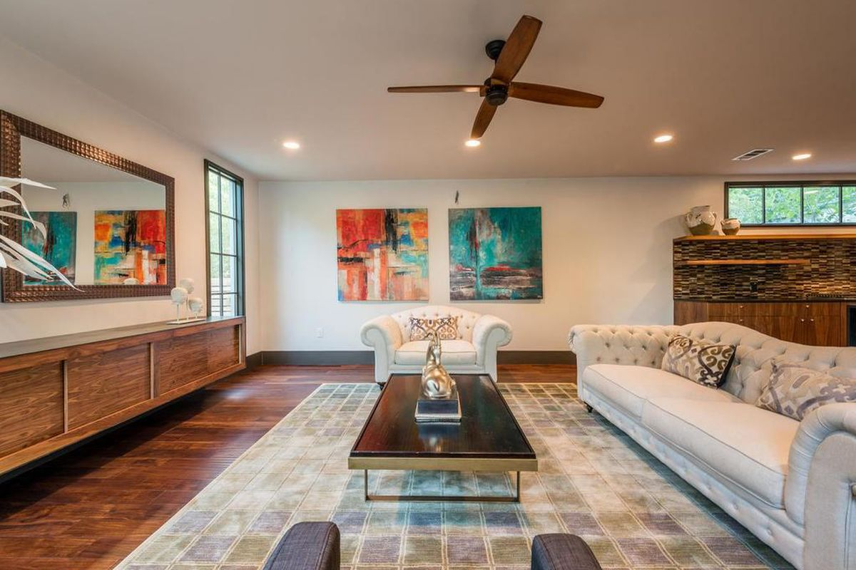 Contemporary living room with colorful paintings on wall