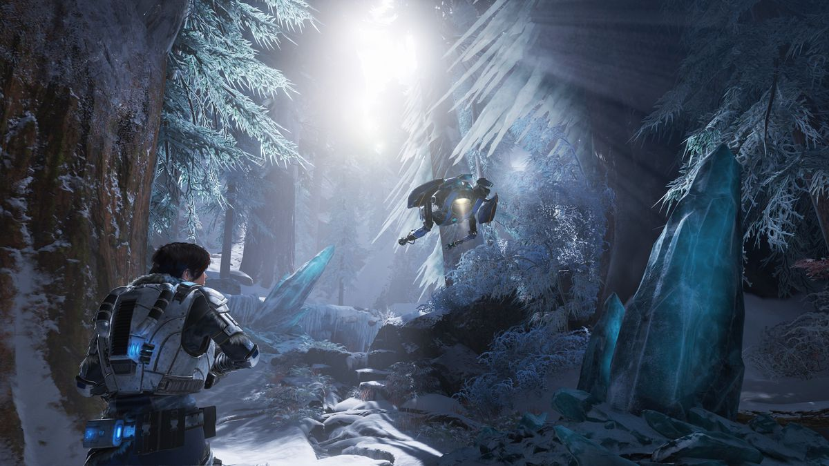 a female soldier, Kait, and her flying robot companion, Jack, explore an icy forest in Gears 5