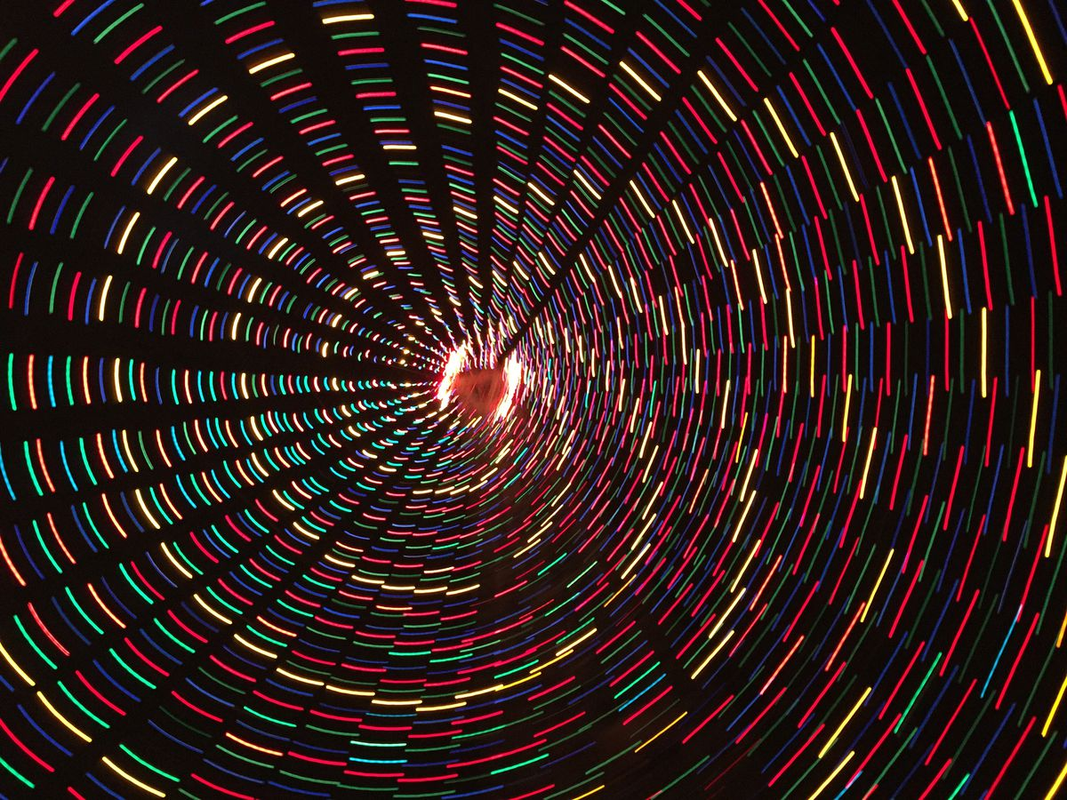 An abstract photo of blurred lights in a spiral.