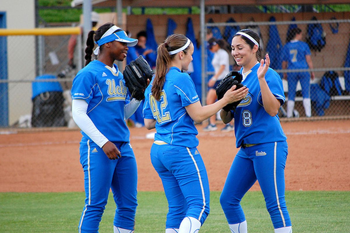 """<em>BB Bates, Devon Lindvall, and Andrea Harrison looking to make history. Photo Credit: <a href=""""http://www.flickr.com/photos/uclasoftball/4407276247/"""" target=""""new"""">UCLA Softball (flickr)</a></em>"""