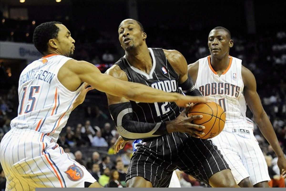 March 6, 2012; Charlotte, NC, USA; Orlando Magic center Dwight Howard (12) gets the ball stripped by Charlotte Bobcats guard Gerald Henderson (15) during the game at Time Warner Cable Arena. Mandatory Credit: Sam Sharpe-US PRESSWIRE