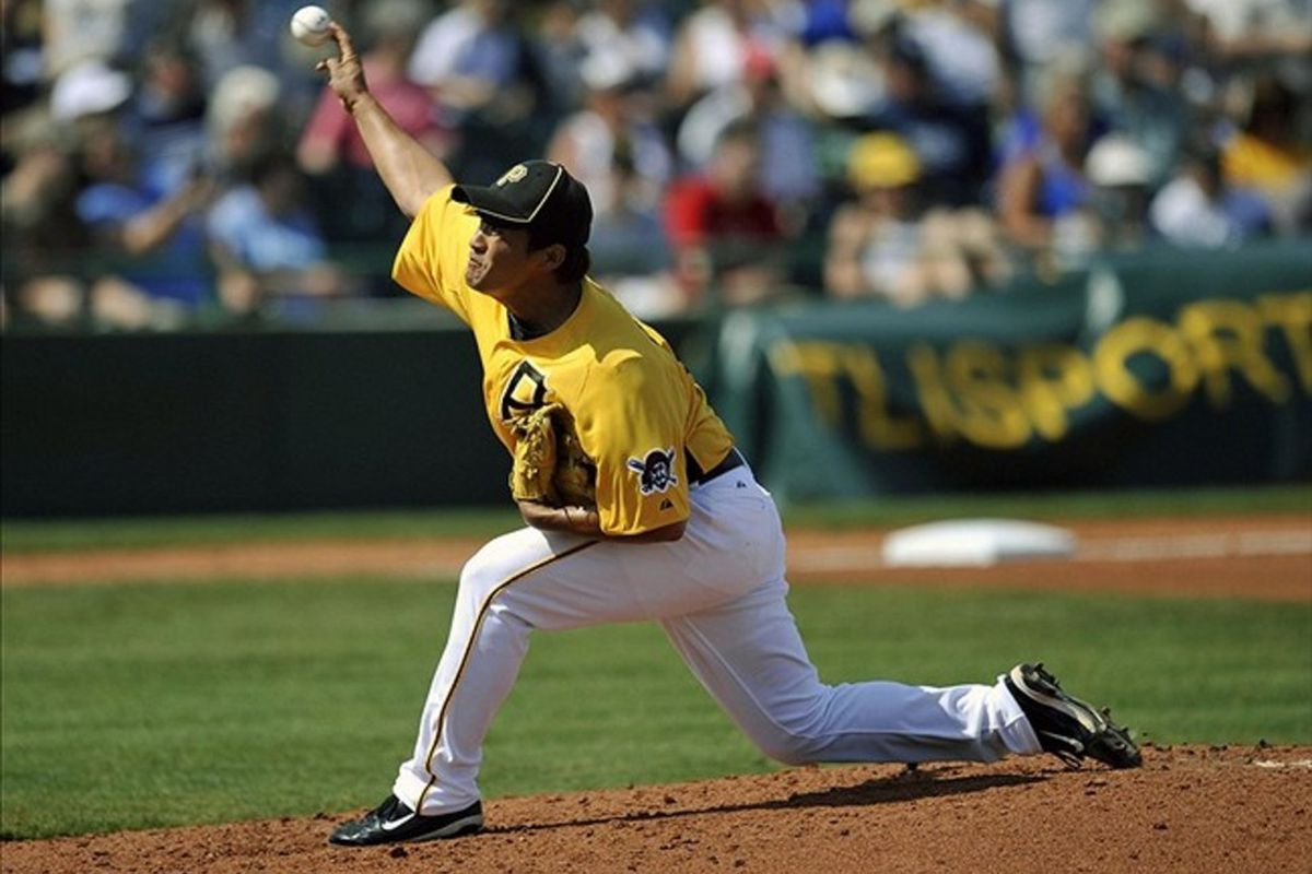 March 6, 2012; Bradenton, FL, USA; Pittsburgh Pirates pitcher Ryota Igarashi (17) throws in the fourth inning against the New York Yankees at McKechnie Field. The Pirates defeated the Yankees 7 - 4. Mandatory Credit: Joy R. Absalon-US PRESSWIRE