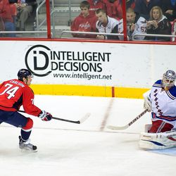Carlson Watches Puck Over Biron
