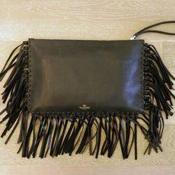 Valentino black leather clutch, $1895
