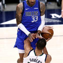 Dallas Mavericks center Willie Cauley-Stein (33) fouls Utah Jazz center Rudy Gobert (27) as the Utah Jazz and the Dallas Mavericks play an NBA basketball game at Vivint Smart Home Arena in Salt Lake City on Wednesday, Jan. 27, 2021.
