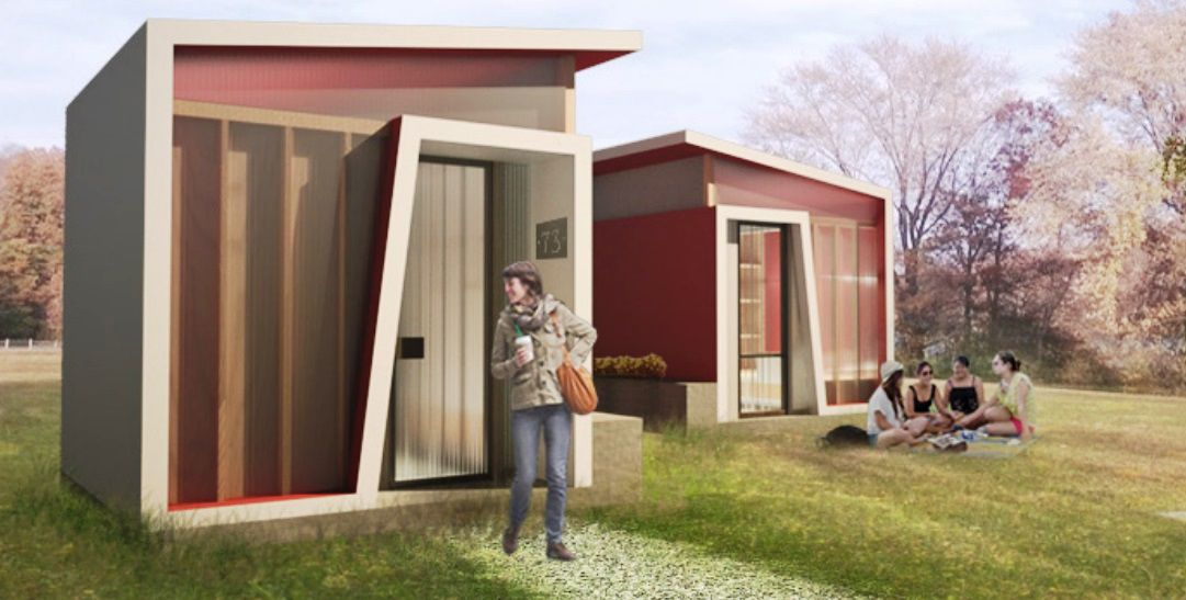 A rendering of designer homeless shacks, red, cube-like units with sloped roofs.