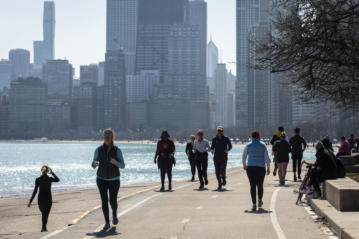 Hundreds could be seen enjoying warm weather on along Lake Michigan near Oak Street Beach, Wednesday
