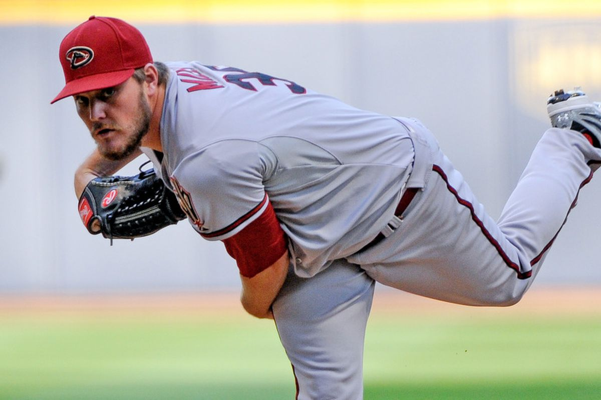 June 30, 2012; Milwaukee, WI, USA;   Arizona Diamondbacks pitcher Wade Miley (36) pitches against the Milwaukee Brewers in the first inning at Miller Park.  Mandatory Credit: Benny Sieu-US PRESSWIRE