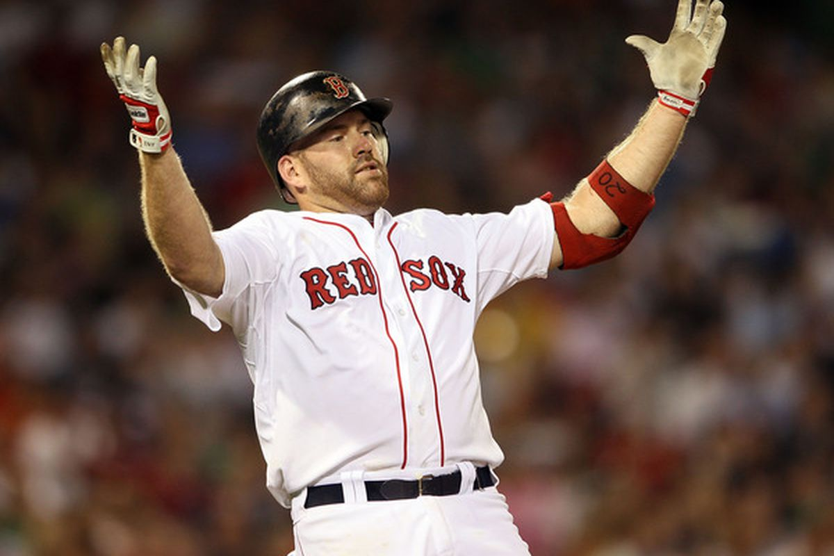 BOSTON - JULY 15:  Kevin Youkilis #20 of the Boston Red Sox reacts after he hit a pop fly out in the sixth inning against the Texas Rangers on July 15 2010 at Fenway Park in Boston Massachusetts.  (Photo by Elsa/Getty Images)