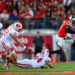 Chris Borland with a diving tackle attempt on Braxton Miller.