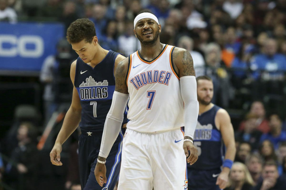 Oklahoma City Thunder forward Carmelo Anthony, foreground, reacts to a call in front of Dallas Mavericks forward Dwight Powell, left, during game in Dallas, Saturday, Nov. 25, 2017.