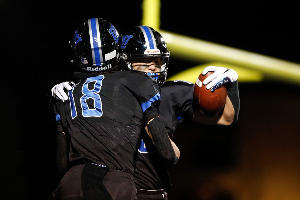 Lincoln-Way East's Jack Tremblay (15) and Max Tomczak (18) celebrate Tremblay's touchdown against Bollingbrook.