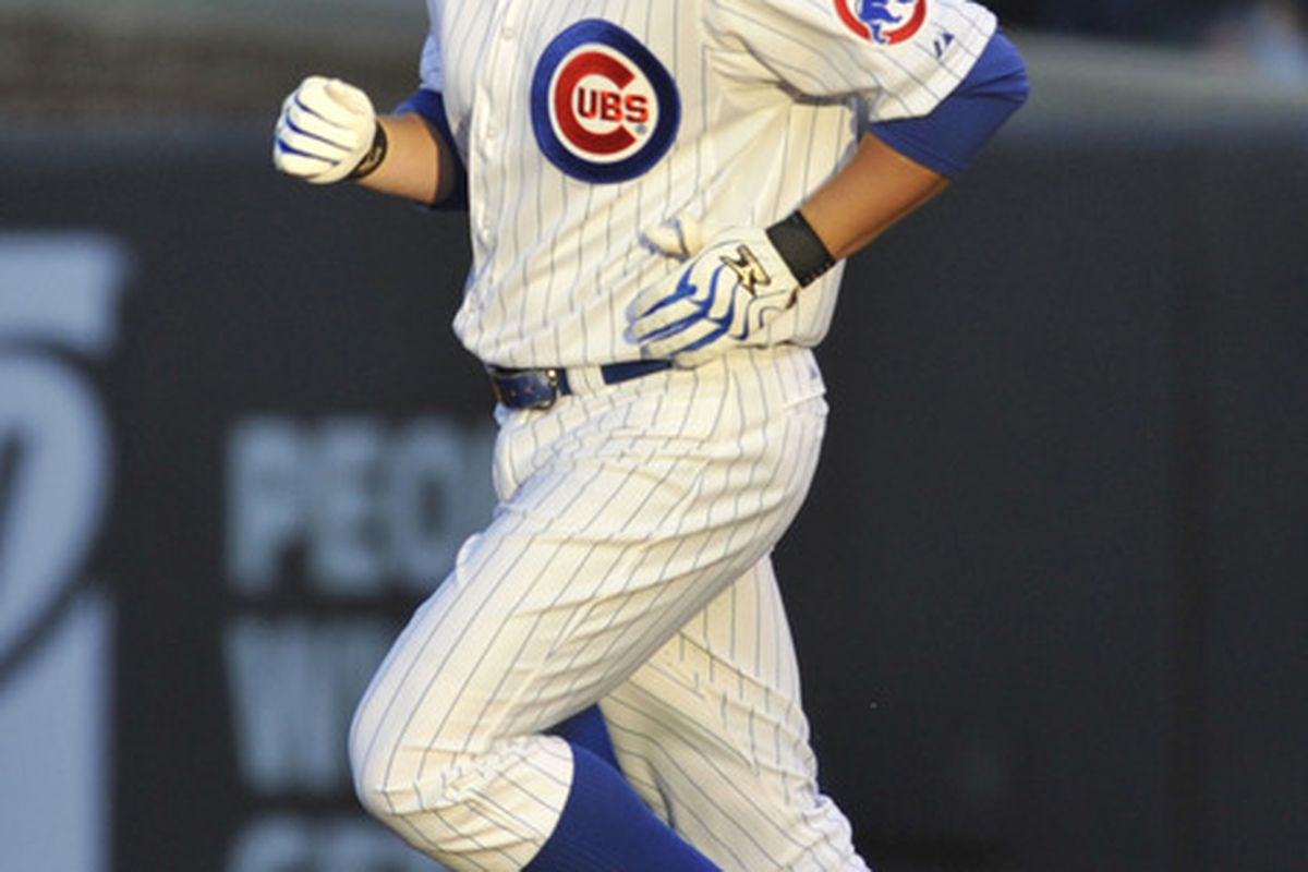 Chicago, IL, USA; Chicago Cubs first baseman Bryan LaHair rounds the bases after hitting a home run against the Milwaukee Brewers in the second inning at Wrigley Field.  Credit: David Banks-US PRESSWIRE