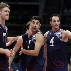 United States' Taylor Sander, center, celebrates with teammates Maxwell Holt, left, and David Lee, right, during a men's preliminary volleyball match against Mexico at the 2016 Summer Olympics in Rio de Janeiro Monday, Aug. 15, 2016.