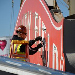 1:46 p.m. A worker removing the neon letters from the marquee -