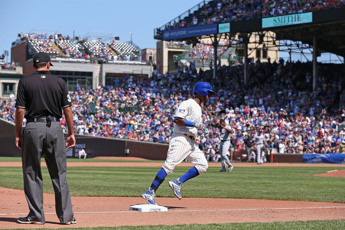 Arismendy Alcantara rounds third base after hitting his first big-league homer (note 3B umpire Pat Hoberg carefully looking to make sure Mendy touched third)