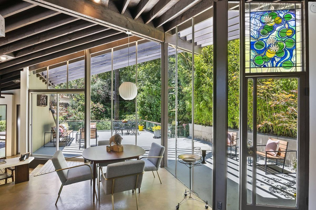 Glass walls overlooking a deck.