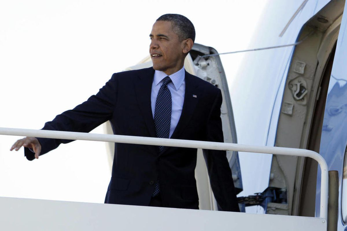 President Barack Obama boards Air Force One, Friday, April 13, 2012, at Andrews Air Force Base, Md., en route to Florida.