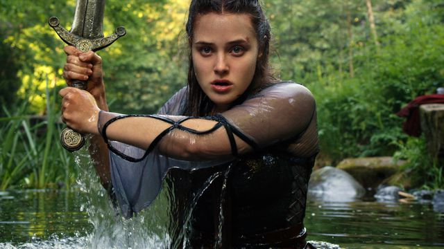 Katherine Langford emerges from the lake with a sword in Cursed