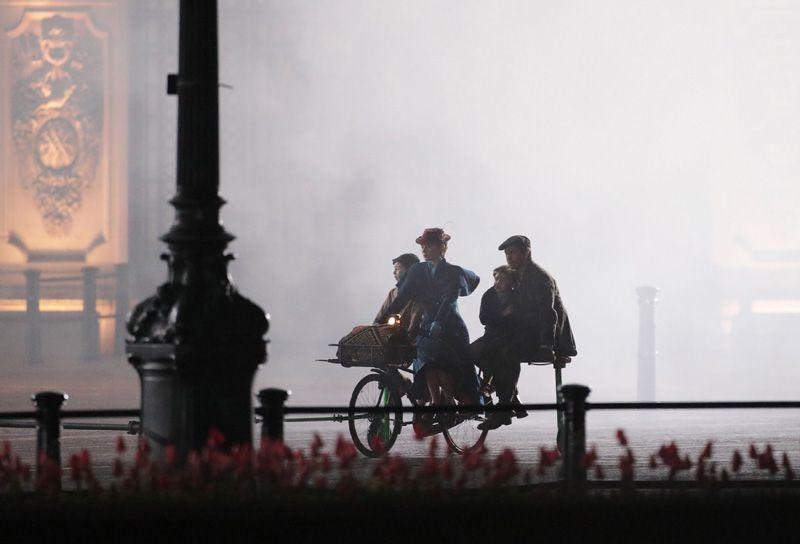 Lin-Manuel Miranda,Emily Blunt,Nathanael Saleh,and Joel Dawson in a production still from Mary Poppins Returns