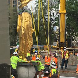 Workers from Jacobsen Construction remove the Angel Moroni statue from atop the Salt Lake Temple of The Church of Jesus Christ of Latter-day Saints in Salt Lake City on Monday, May 18, 2020.The temple is currently undergoing renovation.