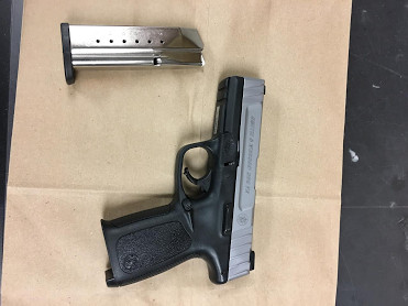 An Evanston man and his mother are facing charges after a 9mm Smith and Wesson handgun was found in their apartment Monday.   Evanston police